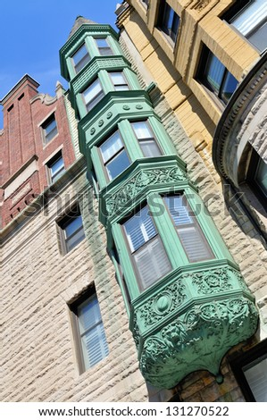 Copper bay windows, low angle view - stock photo