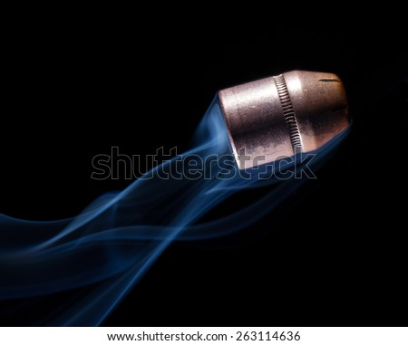 Copper bullets that has smoke coming from behind - stock photo