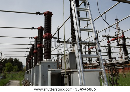 Copper busbars of an electricity transformer at a power plant.Big high voltage power station.Substation with big switches and breakers to operate the electric current.High voltage circuit breaker