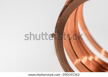 copper coil  with chip modul right cut - stock photo