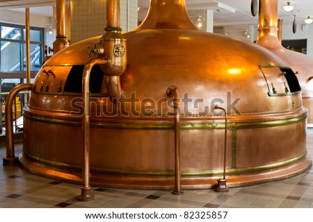 copper distillery tanks in brewery