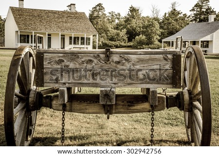 Copper Harbor, Michigan, USA - August 24, 2013. Vintage wooden wagon on display at Fort Wilkins State Historical Park. The park features a restored 1800's US Army fort on the northern frontier. - stock photo