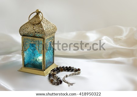 Copper Lightened Lantern with Luxury Rosary  - stock photo