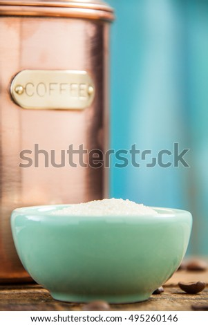 Copper Metal Coffee Can Container Closeup Served With Sugar. Selective Focus With Vertical Copy Space.