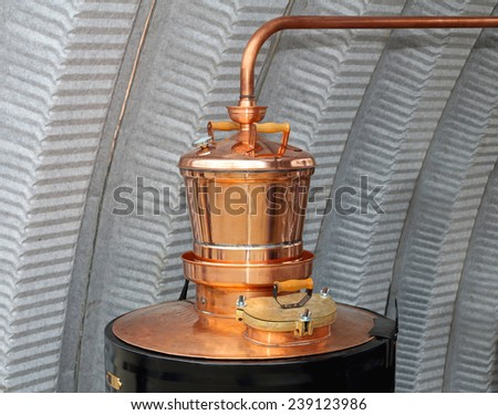 Copper still apparatus for distilling alcohol - stock photo