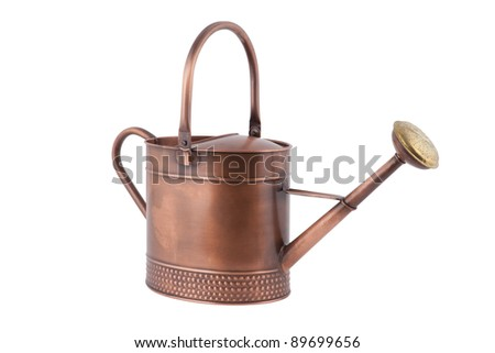 copper watering can - stock photo