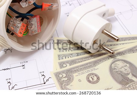 Copper wire connections in electrical box, electric plug and money on construction drawing of house, concept for engineering and energy savings - stock photo