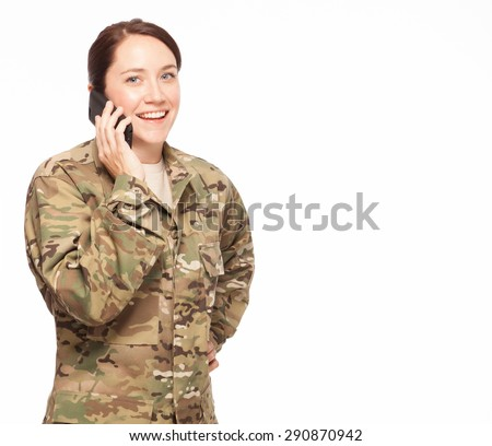 Copy space | Attractive female Army soldier wearing multicam camouflage on her phone. - stock photo