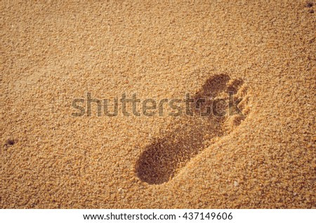 Copy space of footprint on sand beach. Travel concept. Retro color style.