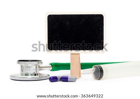 COPY SPACE on chalkboard with stethoscope, syringe and pills. HEALTHCARE and MEDICAL concept - stock photo