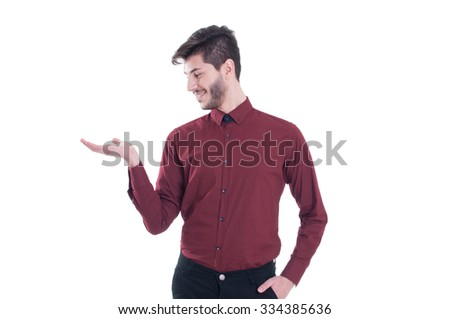 Copy space on his hand. Handsome young man in shirt holding copy space while standing against white background - stock photo