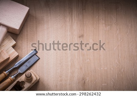 Copy space version of lump hammer planer metal chisels and wooden planks on wood board construction concept. - stock photo