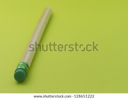 copy space with pencile with green eraser with selective focus - stock photo