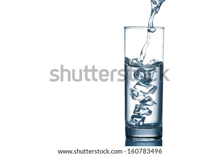Copy-spaced image of pouring water in the glassware isolated on white - stock photo