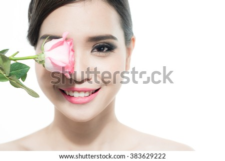 Copy-spaced portrait of a beautiful lady with a rose flower over a white background. Woman day concept. Closeup fresh face girl. - stock photo