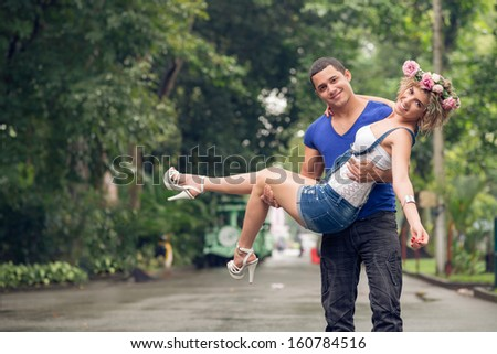 Copy-spaced portrait of a young joyful couple in the park  - stock photo