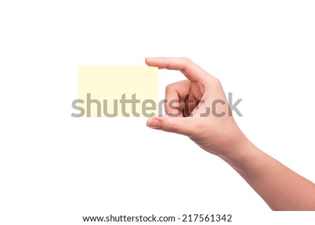Copy-spaced. The hand is grasping the white empty name card  - stock photo