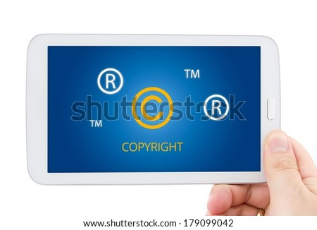 Copyright, registered, trademark symbols on tablet pc display - stock photo