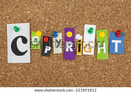 Copyright Single Cut Out Letters Pinned on Cork Board