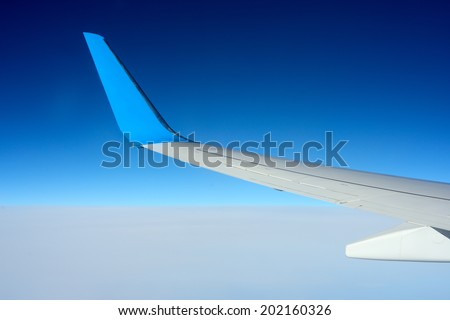 Copyspace airplane wing in the sky - stock photo