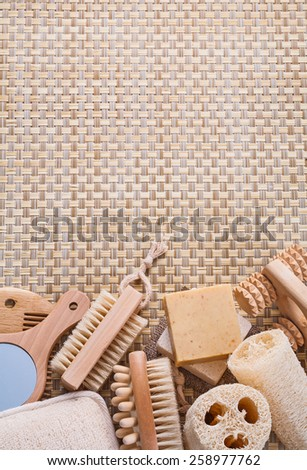 copyspace background big set of classical bathroom accessories on wicker background horizontal version  - stock photo
