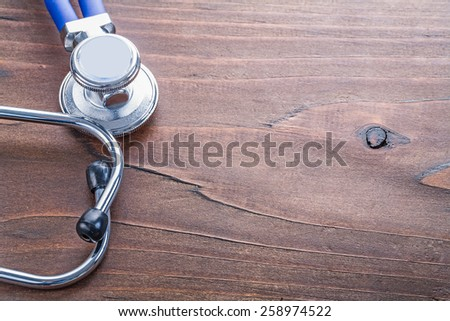 copyspace close up medical stethoscope on vintage wooden board medical comcept  - stock photo