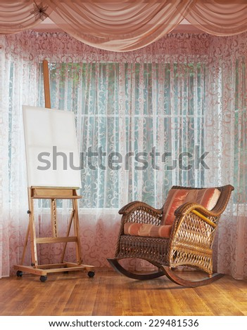 Copyspace empty white canvas on the wooden easel and next to wicker rocking chair, composition against the window's curtains background - stock photo