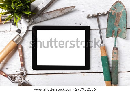 Copyspace frame with gardening tools and objects on old wooden background - stock photo
