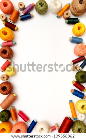 Copyspace frame with sewing threads and clews - stock photo
