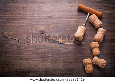 copyspace image classic corkscrew twisted in cork of champagne on vintage wooden board alcohol concept  - stock photo