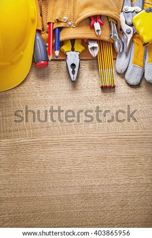 copyspace image working tools in toolbelt on wooden board. - stock photo