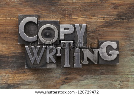 copywriting - text in vintage letterpress metal type blocks on a grunge painted wood - stock photo
