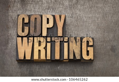 copywriting word - vintage letterpress wood type on a grunge metal background - stock photo
