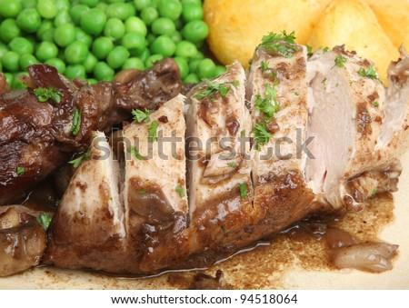 Coq au van. Chicken casseroled in red wine. - stock photo