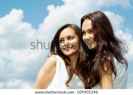 Coquettish brunettes went to rest on the nature - stock photo