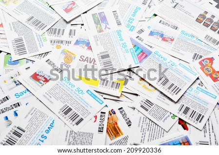 COQUITLAM, BC, CANADA - MAY 8 - Coquitlam BC Canada - May 8, 2014 : Coupons background. All coupons for Canadian store, they are issued by manufacturers of consumer packaged goods Canada.  - stock photo