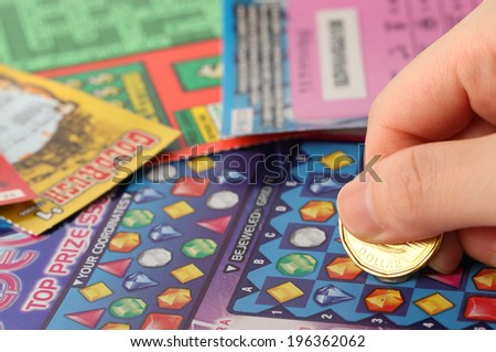 Coquitlam BC Canada - May 25, 2014 : Scratching lottery tickets. The British Columbia Lottery Corporation has provided government sanctioned lottery games in British Columbia since 1985. - stock photo