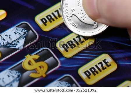 Coquitlam BC Canada - October 24, 2015 : Woman scratching lottery tickets. The British Columbia Lottery Corporation has provided government sanctioned lottery games in British Columbia since 1985. - stock photo