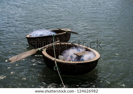 Coracles with fishing nets floating on the water - stock photo