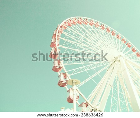 Coral ferris wheel on mint sky  - stock photo