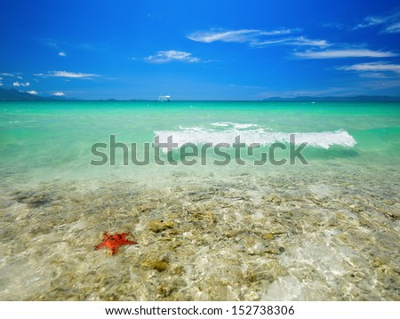 Coral tropical beach on a background of the islands.