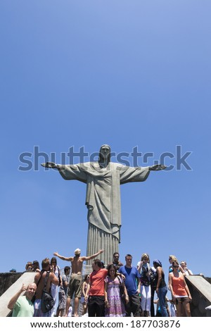 CORCOVADO, RIO DE JANEIRO, BRAZIL - NOVEMBER 2009: tourists standing infront of the Christ The Redeemer statue with blue sky in the background - stock photo