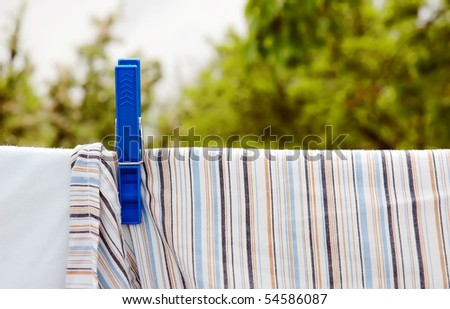 Cord with the laundry and blue peg - stock photo