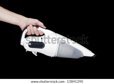Cordless Handheld Vacuum Cleaner, Male Hand, Black Background