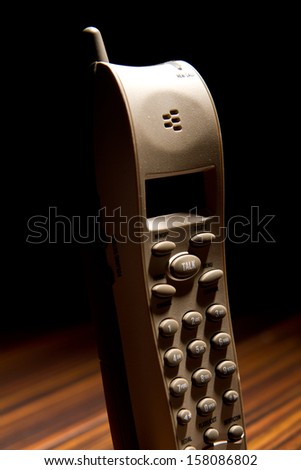 Cordless phone lit from behind - stock photo
