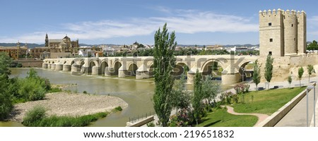 Cordoba. General view with the Roman bridge over the river Guadalquivir and the Mezquita.  - stock photo