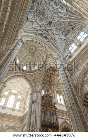 CORDOBA - SPAIN - JUNE 10, 2016 : Cathedral White Ceiling Dome Mezquita Cordoba Spain. Created in 785 as a Mosque, was converted to a Cathedral in the 1500.