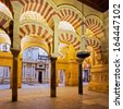 CORDOBA, SPAIN - JUNE 6: Interior view of La Mezquita Cathedral on June 6, 2013 in Cordoba, Spain. The cathedral was built inside of the former Great Mosque. Popular tourist destination in Spain. - stock photo
