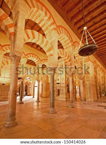 CORDOBA, SPAIN - JUNE 15, 2010: The Great Mosque or Mezquita famous interior in Cordoba, Spain on June 15, 2010. The Great Mosque, currently Catholic cathedral is on the UNESCO World Heritage Site.