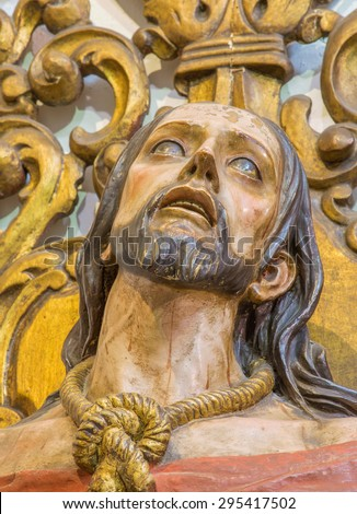 CORDOBA, SPAIN - MAY 26, 2015: The carved bust of Christ in the bond in Church Eremita de Nuestra Senora del Socorro on side altar by unknown artist of 18. cent. - stock photo